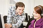 Business people working in headsets Stock Photo - Premium Royalty-Freenull, Code: 649-06041225