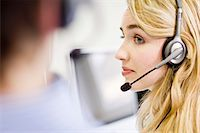 Business people working in headsets Stock Photo - Premium Royalty-Freenull, Code: 649-06041251