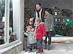 Family admiring Christmas window in snow Stock Photo - Premium Royalty-Free, Artist: Cultura RM, Code: 649-06041421
