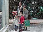 Family Christmas shopping in snow Stock Photo - Premium Royalty-Free, Artist: Cultura RM, Code: 649-06041422