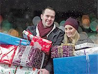 Couple with Christmas gifts in snow Stock Photo - Premium Royalty-Freenull, Code: 649-06041432