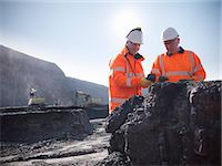 Workers inspecting coal at mine Stock Photo - Premium Royalty-Freenull, Code: 649-06041508