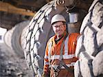 Worker standing by trucks in coal mine Stock Photo - Premium Royalty-Free, Artist: CulturaRM, Code: 649-06041532