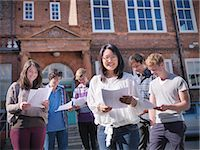 results - Students reading grades together Stock Photo - Premium Royalty-Freenull, Code: 649-06041606