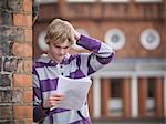 Upset student reading grades at school Stock Photo - Premium Royalty-Free, Artist: Blend Images, Code: 649-06041610