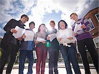 Students reading grades together Stock Photo - Premium Royalty-Freenull, Code: 649-06041611