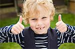 Smiling boy giving thumbs-up outdoors Stock Photo - Premium Royalty-Free, Artist: Robert Harding Images, Code: 649-06041770