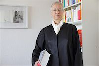 Lawyer holding text book in office Stock Photo - Premium Royalty-Freenull, Code: 649-06041861