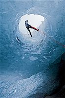 Climber abseiling into ice cave Stock Photo - Premium Royalty-Freenull, Code: 649-06041878