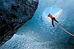 Climber abseiling into ice cave Stock Photo - Premium Royalty-Free, Artist: CulturaRM, Code: 649-06041879