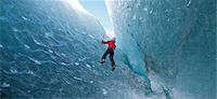 Climber climbing out of ice cave Stock Photo - Premium Royalty-Freenull, Code: 649-06041882