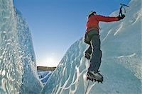 Climber scaling glacier wall Stock Photo - Premium Royalty-Freenull, Code: 649-06041897