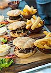 Plates of burgers and french fries Stock Photo - Premium Royalty-Free, Artist: IIC, Code: 649-06041920
