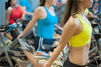 fitness older women gym - People stretching on spin machines Stock Photo - Premium Royalty-Freenull, Code: 649-06041993