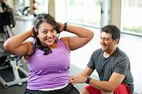 fat man exercising - Woman working with trainer in gym Stock Photo - Premium Royalty-Freenull, Code: 649-06042009