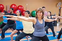 fitness older women gym - People practicing yoga in studio Stock Photo - Premium Royalty-Freenull, Code: 649-06042044