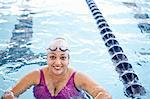 Woman at edge of swimming pool Stock Photo - Premium Royalty-Free, Artist: Andrew Kolb, Code: 649-06042076