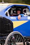 Wheelchair in front of stock car modified for disability racing Stock Photo - Premium Royalty-Free, Artist: Aflo Sport, Code: 6105-06042931