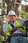 Cable installer working on residential connections at utility pole installing a filter Stock Photo - Premium Royalty-Free, Artist: GreatStock, Code: 6105-06042939