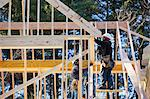 Carpenters using a nail gun on dormer framing Stock Photo - Premium Royalty-Free, Artist: Sergio Pitamitz, Code: 6105-06043023