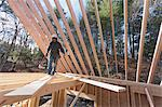 Carpenter walking on a rafter on floor joists Stock Photo - Premium Royalty-Free, Artist: Anthony Redpath, Code: 6105-06043027