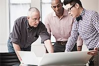 southeast asian - Three business people in meeting Stock Photo - Premium Royalty-Freenull, Code: 614-06043783