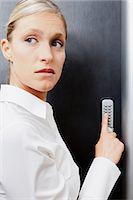 Woman pressing door keypad Stock Photo - Premium Royalty-Freenull, Code: 614-06043931