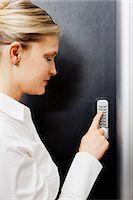 Woman pressing door keypad Stock Photo - Premium Royalty-Freenull, Code: 614-06043932