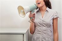 Young woman holding megaphone Stock Photo - Premium Royalty-Freenull, Code: 614-06043960