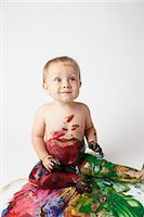 finger painting - Baby covered in messy paint Stock Photo - Premium Royalty-Freenull, Code: 614-06043997