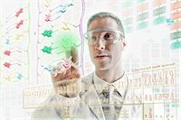 Scientist interacting with holographic screens Stock Photo - Premium Royalty-Freenull, Code: 614-06044013
