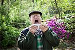 Senior man about to sneeze outdoors Stock Photo - Premium Royalty-Freenull, Code: 614-06044633