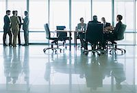 Business people meeting in separate groups in conference room Stock Photo - Premium Royalty-Freenull, Code: 635-06045026