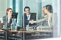 Business people shaking hands at table in conference room Stock Photo - Premium Royalty-Freenull, Code: 635-06045037