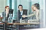 Business people shaking hands at table in conference room Stock Photo - Premium Royalty-Free, Artist: Blend Images, Code: 635-06045037
