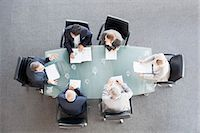 Business people meeting at table in conference room Stock Photo - Premium Royalty-Freenull, Code: 635-06045042