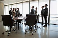 Separate groups of business people facing off in conference room Stock Photo - Premium Royalty-Freenull, Code: 635-06045052