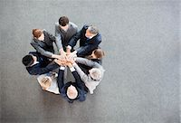 Business people stacking hands in circle Stock Photo - Premium Royalty-Freenull, Code: 635-06045059