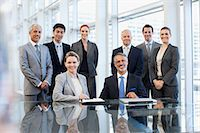 Portrait of smiling business people in conference room Stock Photo - Premium Royalty-Freenull, Code: 635-06045061