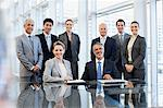 Portrait of smiling business people in conference room Stock Photo - Premium Royalty-Free, Artist: Mitch Tobias, Code: 635-06045061