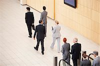 Business people stepping off escalator Stock Photo - Premium Royalty-Freenull, Code: 635-06045069