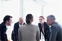 Business people leaning in circle and talking Stock Photo - Premium Royalty-Freenull, Code: 635-06045072