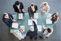 Business people shaking hands across conference room table Stock Photo - Premium Royalty-Freenull, Code: 635-06045074