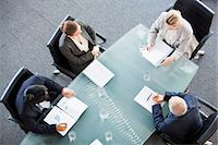 Business people meeting at table in conference room Stock Photo - Premium Royalty-Freenull, Code: 635-06045079