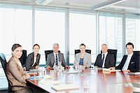 Portrait of smiling business people at table in conference room Stock Photo - Premium Royalty-Freenull, Code: 635-06045083