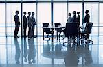 Separate groups of business people facing off in conference room Stock Photo - Premium Royalty-Free, Artist: Blend Images, Code: 635-06045091
