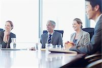 Smiling business people sitting at conference room table Stock Photo - Premium Royalty-Freenull, Code: 635-06045107
