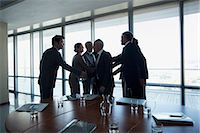 Business people shaking hands in conference room Stock Photo - Premium Royalty-Freenull, Code: 635-06045110