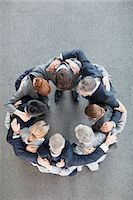 Business people in huddle Stock Photo - Premium Royalty-Freenull, Code: 635-06045112