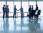 Business people shaking hands in conference room Stock Photo - Premium Royalty-Freenull, Code: 635-06045115